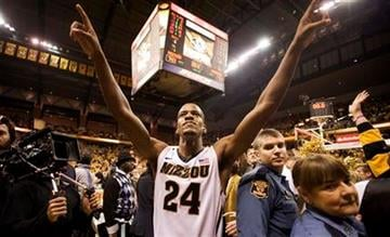 Missouri's Kim English celebrates as he walks off the court after his team defeated Kansas 74-71 in an NCAA college basketball game on Saturday, Feb. 4, 2012, in Columbia, Mo. (AP Photo/L.G. Patterson) By L.G. PATTERSON