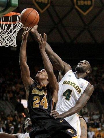 Missouri guard Kim English (24) has his shot attempt slapped away by Baylor 's Quincy Acy (4) in the first half of an NCAA basketball game, Saturday, Jan. 21, 2012, in Waco, Texas. (AP Photo/Tony Gutierrez) By Tony Gutierrez
