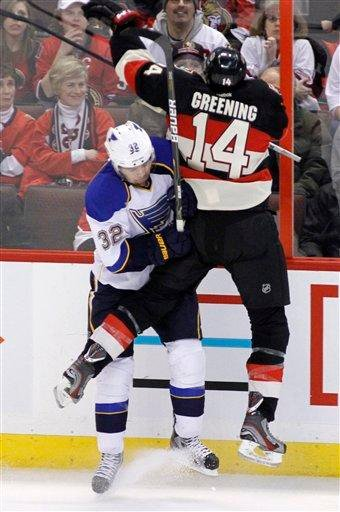 St. Louis Blues' Chris Porter (32) checks Ottawa Senators' Collin Greening (14) along the boards during the first period of an NHL hockey game in Ottawa, Ontario, on Tuesday, Feb. 7, 2012. (AP Photo/The Canadian Press, Fred Chartrand) By Fred Chartrand