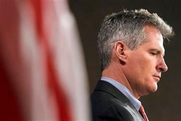 Sen. Scott Brown, R-Mass. listens during a news conference on Capitol Hill in Washington, Tuesday, Jan. 31, 2012, to discuss the Stop Trading on Congressional Knowledge Act, or STOCK.  (AP Photo/Jacquelyn Martin) By Jacquelyn Martin