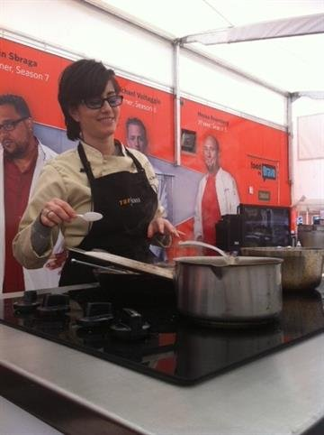 """""""Top Chef"""" contestants Nikki Cascone (Season Four) and Hector Santiago (Season Six) compete in a live, interactive cook-off at Soulard Farmers Market. Great Day St. Louis' Virginia Kerr acted as guest judge for the food battle! By Lakisha Jackson"""
