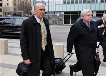 NFL vice presidents Peter Ruocco, left, and Dennis Curran arrive at the federal courthouse Friday, April 15, 2011 in Minneapolis, for the second day of court-ordered mediation between the NFL and its locked-out players. (AP Photo/Jim Mone) By Jim Mone