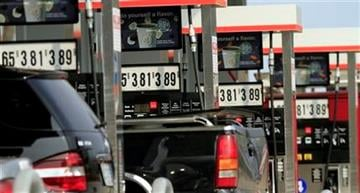 Gas pumps are lined up, Monday, April 11, 2011 in Laconia, N.H. (AP Photo/Jim Cole) By Jim Cole