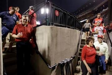 Baseball fans seek shelter as tornado sirens sound before a baseball game between the St. Louis Cardinals and the Washington Nationals on Tuesday, April 19, 2011, in St. Louis. (AP Photo/Jeff Roberson) By Jeff Roberson