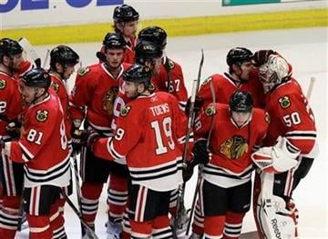 Chicago Blackhawks celebrate after beating the Vancouver Canucks 7-2 in Game 4 of an NHL hockey Stanley Cup playoffs first-round series Tuesday, April 19, 2011, in Chicago. Vancouver leads the series 3-1. (AP Photo/Nam Y. Huh) By Nam Y. Huh