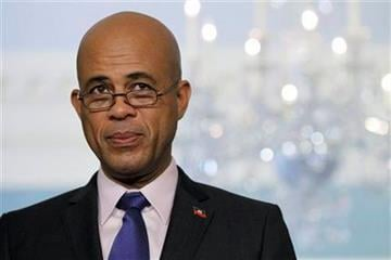 Haiti's President-elect Michel Martelly speaks during a joint news conference with Secretary of State Hillary Rodham Clinton at the State Department in Washington, Wednesday, April 20, 2011. (AP Photo/Alex Brandon) By Alex Brandon