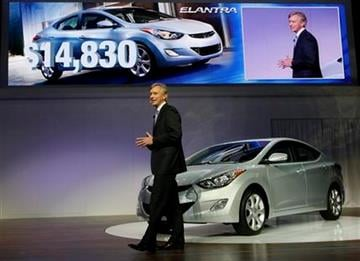 John Krafcik, President and CEO of Hyundai Motor America announces the base price for the 2011 Hyundai Elantra, as it is unveiled at the 2010 Los Angeles Auto Show Thursday, Nov. 18, 2010. (AP Photo/Damian Dovarganes) By Damian Dovarganes