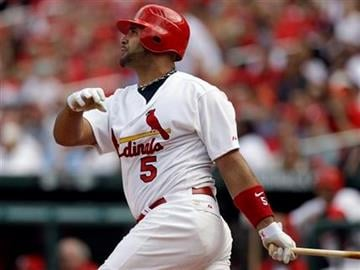 St. Louis Cardinals' Albert Pujols watches his solo home run during the third inning of a baseball game against the San Diego Padres, Saturday, April 2, 2011, in St. Louis. (AP Photo/Jeff Roberson) By Jeff Roberson
