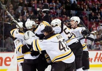 Boston Bruins' players celebrate after defeating the Montreal Canadiens in overtime of Game 4 of a first-round NHL Stanley Cup playoff series in Montreal, Thursday, April 21, 2011. (AP Photo/The Canadian Press, Graham Hughes) By Graham Hughes