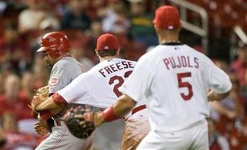 St. Louis Cardinals third baseman David Freese tags out Cincinnati Reds' Miguel Cairo as he attempts to steal third during the eighth inning of a baseball game Friday, April 22, 2011, in St. Louis. (AP Photo/Jeff Curry) By Jeff Curry