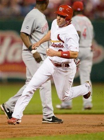 St. Louis Cardinals' Ryan Theriot heads for third base during the first inning of a baseball game against the Cincinnati Reds Friday, April 22, 2011, in St. Louis. (AP Photo/Jeff Curry) By Jeff Curry