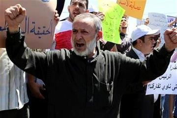 A Syrian protester shouts slogans during a protest to express solidarity with Syrian people and calling for President Bashar Assad to step down, in front of Syrian embassy in Amman, Jordan, Sunday April, 24, 2011.(AP Photo/ Nader Daoud) By Nader Daoud
