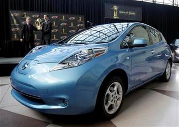 The Nissan Leaf is presented as the 2011 World Car of the Year at the New York International Auto Show Thursday, April 21, 2011. (AP Photo/Richard Drew) By Richard Drew