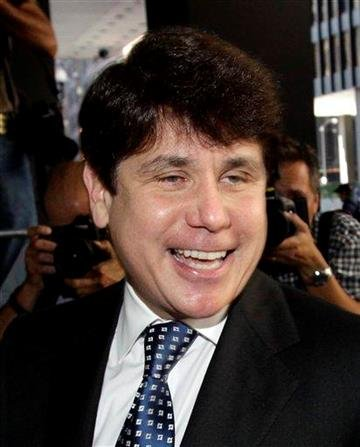 Former Illinois Gov. Rod Blagojevich laughs as he arrives at the Federal Court building for closing arguments in his federal corruption trial Tuesday, July 27, 2010 in Chicago.  (AP Photo/Charles Rex Arbogast) By Charles Rex Arbogast