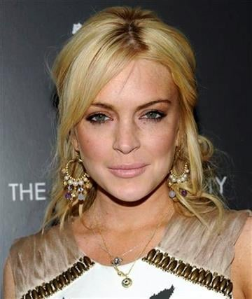 """Actress Lindsay Lohan attends a screening of """"Source Code"""" hosted by the Cinema Society at the Crosby Street Hotel on Thursday, March 31, 2011 in New York. (AP Photo/Evan Agostini) By Evan Agostini"""