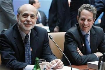 Federal Reserve Chairman Ben Bernanke, left, sits with Treasury Secretary Timothy Geithner before a meeting of the G-20, Friday, April 15, 2011, at the World Bank/IMF Spring Meetings 2011 in Washington. (AP Photo/Jacquelyn Martin) By Jacquelyn Martin