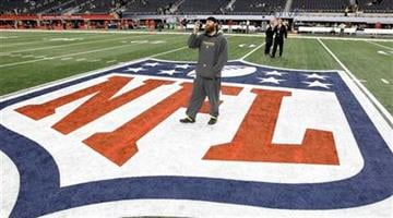 Pittsburgh Steelers' Brett Keisel takes a photo on the field before the NFL football Super Bowl XLV game against the Green Bay Packers Sunday, Feb. 6, 2011, in Arlington, Texas. (AP Photo/David J. Phillip) By David J. Phillip
