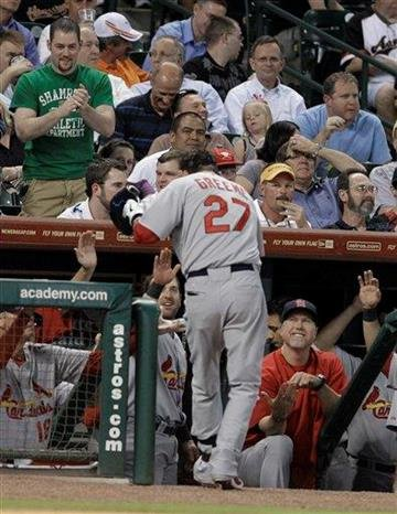 St. Louis Cardinals' Tyler Greene (27) is welcomed back to the dugout after hitting a solo home run in the fifth inning of a baseball game against the Houston Astros on Wednesday, April 27, 2011, in Houston. (AP Photo/Pat Sullivan) By Pat Sullivan