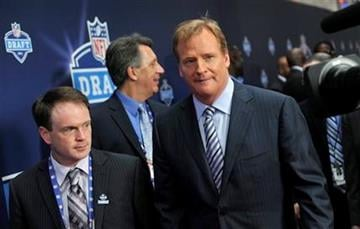NFL commissioner Roger Goodell, right, arrives for the first round of the NFL football draft at Radio City Music Hall on Thursday, April 28, 2011, in New York. (AP Photo/Stephen Chernin) By Stephen Chernin