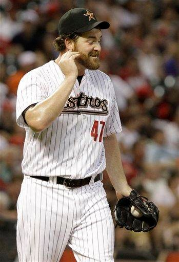 Houston Astros relief pitcher Jeff Fulchino scratches his beard after giving up a single to St. Louis Cardinals' Albert Pujols in the sixth inning of a baseball game Thursday, April 28, 2011, in Houston. (AP Photo/Pat Sullivan) By Pat Sullivan
