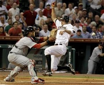 Houston Astros' Hunter Pence, right, beats the ball in to home plate as St. Louis Cardinals catcher Gerald Laird, left, waits in the sixth inning of a baseball game Thursday, April 28, 2011, in Houston. (AP Photo/Pat Sullivan) By Pat Sullivan