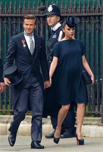 British soccer player David Beckham, left, and his wife, British fashion designer Victoria Beckham arrive at Westminster Abbey for the Royal Wedding in London, Friday, April, 29, 2011. (AP Photo/Fiona Hanson, Pool) By Fiona Hanson