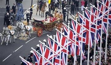 Britain's Prince William and Kate, the Duchess of Cambridge, wave as they travel in the 1902 State Landau carriage along the processional route to Buckingham Palace, London, Friday April 29, 2011. (AP Photo/Damien Meyer, Pool) By Damien Meyer