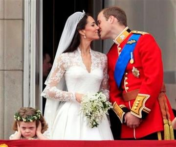 Britain's Prince William kisses his wife Kate, Duchess of Cambridge on the balcony of Buckingham Palace after the Royal Wedding in London Friday, April, 29, 2011. (AP Photo/Matt Dunham) By Matt Dunham