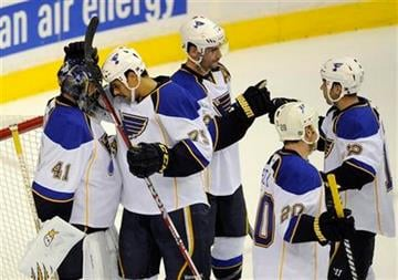 St. Louis Blues goalie Jaroslav Halak (41), of Slovakia, celebrates 2-1 win over the Washington Capitals with teammate Ryan Reaves, second from left, in an NHL hockey game, Tuesday, Nov. 29, 2011, in Washington. (AP Photo/Nick Wass) By Nick Wass
