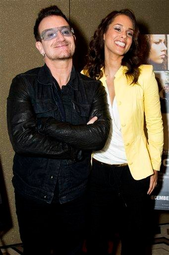 """Bono, left, and Alicia Keys attend the premiere of the Showtime documentary """"Keep a Child Alive with Alicia Keys"""", in New York, Tuesday, Nov. 29, 2011. (AP Photo/Charles Sykes) By Charles Sykes"""