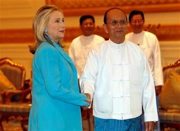 U.S. Secretary of State Hillary Rodham Clinton, left, is greeted by Myanmar's President Thein Sein at the president's office in Naypyidaw, Myanmar Thursday, Dec, 1, 2011. (AP Photo/Vincent Thian) By Vincent Thian