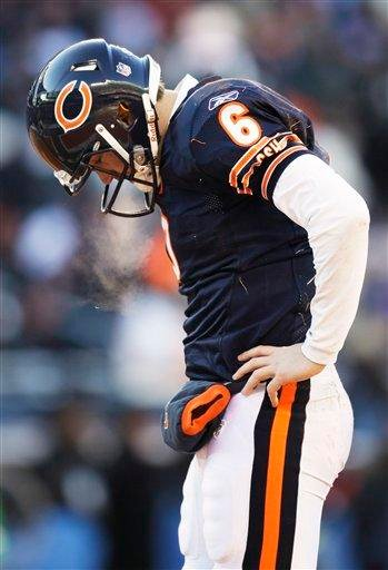 Chicago Bears quarterback Jay Cutler looks down after being hit while throwing a pass during the first half of the NFC Championship NFL football game against the Green Bay Packers Sunday, Jan. 23, 2011, in Chicago. (AP Photo/Nam Y. Huh) By Nam Y. Huh