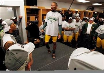 Green Bay Packers' Charles Woodson talks to teammates in the locker room after the NFC Championship NFL football game against the Chicago Bears Sunday, Jan. 23, 2011, in Chicago. The Packers won 21-14. (AP Photo/David J. Philip) By David J. Philip