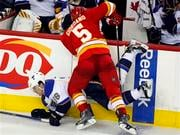 St Louis Blues' Matt D'Agostini, left, gets knocked to the ice by Calgary Flames' Mark Giordano during the second period of an NHL hockey game in Calgary, Alberta, Wednesday, Jan. 26, 2011. (AP Photo/The Canadian Press, Jeff McIntosh) By Jeff McIntosh