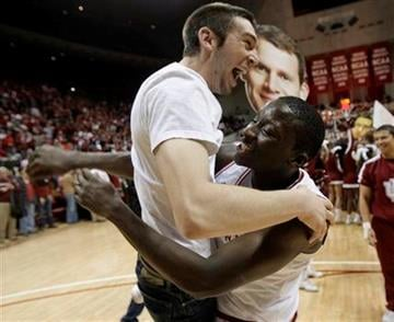 Indiana guard Victor Oladipo, right, reacts with a fan after Indiana defeated No. 20 Illinois 52-49 in an NCAA college basketball game in Bloomington, Ind., Thursday, Jan. 27, 2011. (AP Photo/Darron Cummings) By Darron Cummings