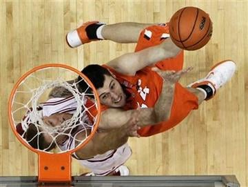 Illinois center Mike Tisdale (54) puts up a shot against Indiana forward Derek Elston during the second half of an NCAA college basketball game in Bloomington, Ind., Thursday, Jan. 27, 2011. Indiana won 52-49. (AP Photo/Darron Cummings) By Darron Cummings