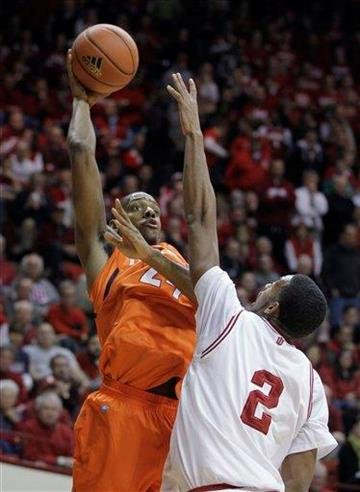 Illinois forward Mike Davis (24) shoots over Indiana forward Christian Watford (2) during the first half of an NCAA college basketball game in Bloomington, Ind., Thursday, Jan. 27, 2011. (AP Photo/Darron Cummings) By Darron Cummings
