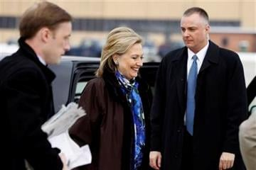 Secretary of State Hillary Rodham Clinton boards her plane for a trip to Haiti at Andrews AFB, Md., Sunday, Jan. 30, 2011.(AP Photo/Alex Brandon, Pool) By Alex Brandon
