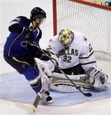 St. Louis Blues' Andy McDonald, left, is unable to get the puck past Dallas Stars goalie Kari Lehtonen, of Finland, during the first period of an NHL preseason hockey game Saturday, Oct. 2, 2010, in St. Louis. (AP Photo/Jeff Roberson) By Jeff Roberson