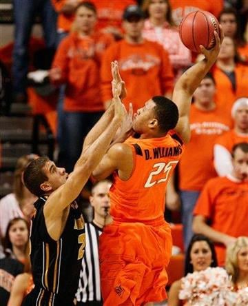 Oklahoma's Darrell Williams, right, shoots over Missouri's Justin Safford during the first half of an NCAA college basketball game Wednesday, Feb. 2, 2011, in Stillwater, Okla. (AP Photo/James Schammerhorn) By James Schammerhorn