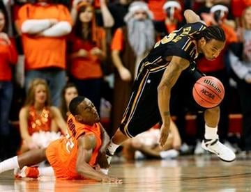 Missouri's Marcus Dixon Jr., right, steals the ball from Oklahoma State's Markel Brown during the first half of an NCAA college basketball game Wednesday, Feb. 2, 2011, in Stillwater, Okla. (AP Photo/James Schammerhorn) By James Schammerhorn