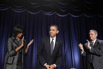 President Barack Obama is applauded by first lady Michelle Obama and Rep. Jeff Miller, R-Fla., after he spoke at the National Prayer Breakfast in Washington, Thursday, Feb. 3, 2011. (AP Photo/Charles Dharapak) By Charles Dharapak