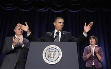 President Barack Obama stands with Rep. Jeff Miller, R-Fla., left, and Rep. Ann Kirkpatrick, D-Ariz., before addressing the National Prayer Breakfast in Washington, Thursday, Feb. 3, 2011. (AP Photo/Charles Dharapak) By Charles Dharapak