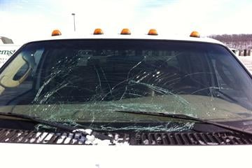 My husband was lucky that he didn't wreck after this ice chunk hit his windshield at 60 mph. By Afton Spriggs