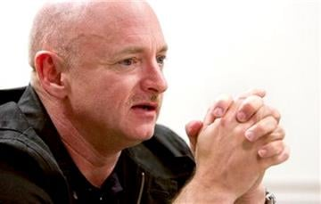 Mark Kelly, husband of Rep. Gabrielle Giffords, talks about his life with Gabby Tuesday, Jan. 18, 2011 at the University Medical Center in Tucson, Az. (AP Photo/The Arizona Republic, Tom Tingle)  MARICOPA COUNTY OUT; MAGS OUT; NO SALES By Tom Tingle