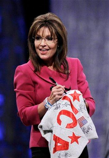Former Republican vice presidential candidate Sarah Palin signs her autograph on a shirt after addressing the National Quartet Convention in Louisville, Ky., Thursday, Sept. 16, 2010.  (AP Photo/Ed Reinke) By Ed Reinke
