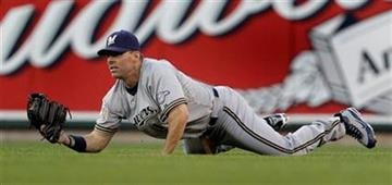 Milwaukee Brewers center fielder Jim Edmonds dives to catch a ball hit by St. Louis Cardinals' Yadier Molina to end the second inning of a baseball game Thursday, July 1, 2010, in St. Louis. (AP Photo/Jeff Roberson) By Jeff Roberson
