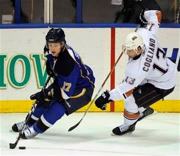 St. Louis Blues' Vladimir Sobotka (17), of Czech Republic, gets the puck around Edmonton Oilers' Andrew Cogliano (13) in the second period of an NHL hockey game, Friday, Feb. 4, 2011, in St. Louis. The Blues won 5-3. (AP Photo/Bill Boyce) By Bill Boyce