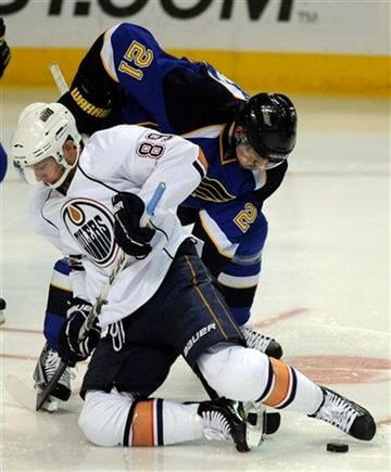 Edmonton Oilers' Sam Gagner (89) battles with St. Louis Blues' Patrik Berglund (21), of Sweden, in the second period of an NHL hockey game, Friday, Feb. 4, 2011, in St. Louis. (AP Photo/Bill Boyce) By Bill Boyce