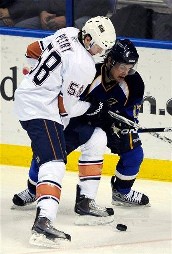 Edmonton Oilers' Jeff Petry (58) and St. Louis Blues' Vladimir Sobotka (17), of Czech Republic, battle for the puck in the second period of an NHL hockey game, Friday, Feb. 4, 2011, in St. Louis. (AP Photo/Bill Boyce) By Bill Boyce